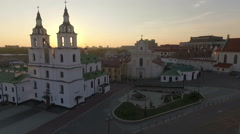 Church under the amazing sunset, flying over the old european town Stock Footage