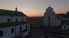 Sunset above an old  church in the european town Stock Footage