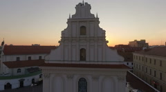 Sunset above a church and old european town, amazing aerial footage Stock Footage
