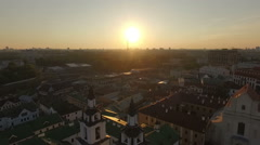 Sun sets above an old european town with castles and church Stock Footage