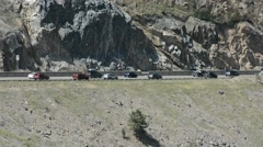 Slow Moving Traffic Jam Merging on an Interstate in the Mountains on a Sunny Day Stock Footage