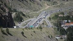 Slow Moving Traffic Jam Merging onto Interstate 70 in the Mountains Stock Footage