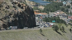Slow Moving Traffic Jam Around a Curve in the Mountains with a Reservoir Stock Footage