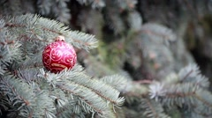 Christmas tree branch decorated with red ball. Holiday background Stock Footage