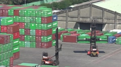Two reach stackers in the container terminal. 4K Stock Footage