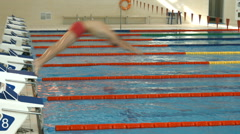 Professional swimmer jumps into the pool Stock Footage
