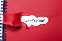 The words what's next appearing behind torn paper Stock Photos