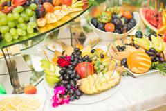 Authentic buffet, assorted fresh fruits, berries and citrus. Preparation for Stock Photos
