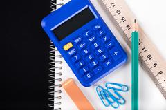 Calculator and Office supplies close-up Stock Photos