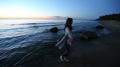Life style of the girl on the beach after sunset Stock Footage