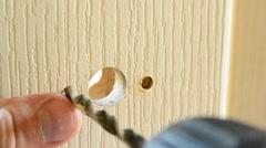 Drilling hole in a door to install door lock or handle Stock Footage