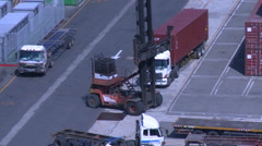 A reach stacker crane in a container depot. Stock Footage