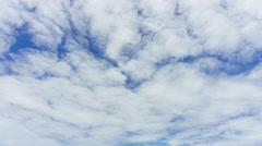Time-lapse : Cloudscape timelapse, white clouds running across the blue sky. Stock Footage