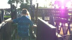 Kids running around the playground Stock Footage