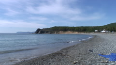 Sea waves surf on stony rocks beach. Japan Sea. Stock Footage