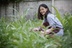 Younger asian woman in home gardening ,hipster people lifestyle Stock Photos