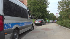 Police van parked in street during WYD in Krakow, Poland - zoom out Stock Footage