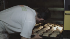 Baker pushes Bun into the oven Stock Footage