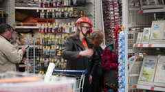 SuperMarket, clowns look at the products Stock Footage