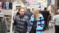 SuperMarket, People walk between the shelves  Stock Footage