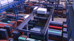 A gantry crane is stacking containers in the containers terminal. Stock Footage