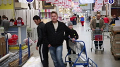 SuperMarket, man and boy wheeled cart Stock Footage