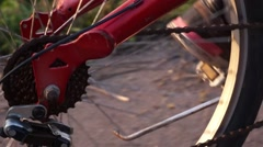 Rear wheel of a bicycle  for a trip on summer road close-up Stock Footage