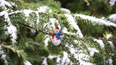 Christmas decoration on Christmas tree covered with real snow. Stock Footage