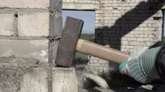 Construction worker using sledgehammer Stock Footage