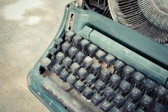 Typewriter on wood Stock Photos