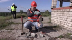 Construction worker keep the power cord Stock Footage