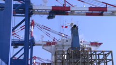 Gantry cranes are unloading containers of a large ship in the Port of Kaohsiung Stock Footage
