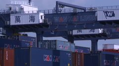 A gantry crane unloading a container of a large ship in Port of Kaohsiung Stock Footage