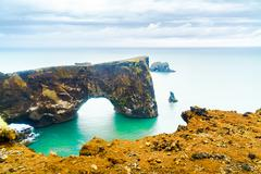 Natural Arch, the rock formation at the cape Dyrholaey Stock Photos