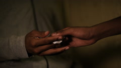 Close up of hands doing a drug deal, in slow motion Stock Footage