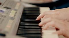 Close up shot man playing piano Stock Footage