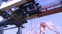 The spreader of a gantry crane is moving in the Port of Kaohsiung, Taiwan. Stock Footage