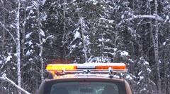 Car with  flashing amber warning lightbar at winter. Stock Footage