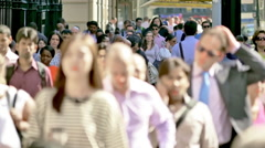 NYC commuters walk crowd large business people New York City sunny slow motion Stock Footage