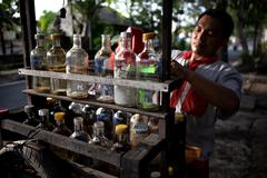 Bali, Indonesia - Feb 4, 2014 : sale of petrol on the road Stock Photos