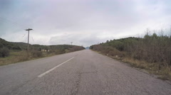 POV travel rural car vehicle drive countryside road cloudy sky point of view Stock Footage