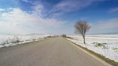 POV car vehicle drive snow open road fields valley blue sky point of view winter Stock Footage
