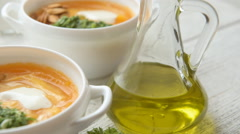 Pumpkin soup with pesto and roasted seeds Stock Footage