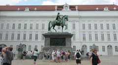 Equestrian statues of Holy Roman Emperor Joseph II at Josefsplatz in front of th Stock Footage