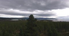 Aerial view over a northern wilderness, coniferous wood, lake in Norway Stock Footage