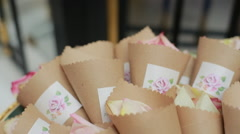 Wicker basket containing small paper containers full of roses. Stock Footage