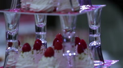 Delicious decorated candy bar, sweets on tables for wedding reception Stock Footage