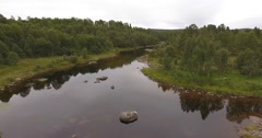 Aerial view of a silent river in a remote northern woodland Stock Footage