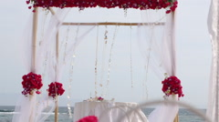 Wedding arch decorated with flowers and glass hanging vases Stock Footage
