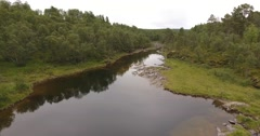 Slow low level flight , aerial view of a silent river in northern woodland Stock Footage